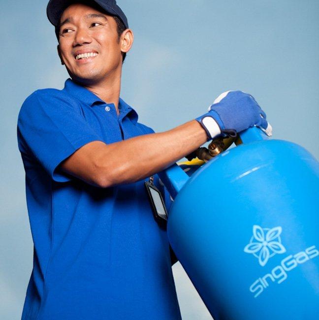 SingGas Employee carying lpg gas